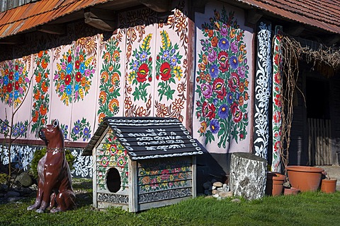 Blue window, traditional old wooden farm and kennel painted with colorful flowers, village Zalipie, near Tarnow, Lesser Poland, Poland, Europe