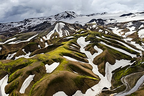 Aerial view, rhyolite mountains partially covered with snow, Landmannalaugar, Fjallabak conservation area, Icelandic Highlands, Iceland, Europe