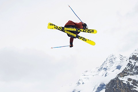 Trick skier jumping, in front of Eiger Mountain, Mürren, Bernese Oberland, Canton of Bern, Switzerland