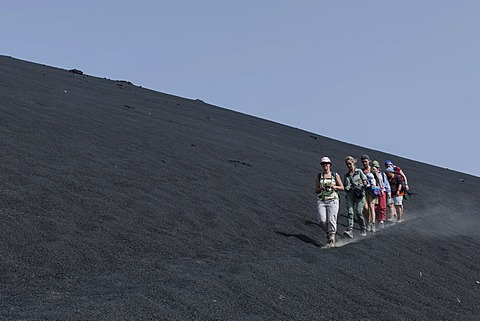 Hikers in the ash field of the Pico do Fogo volcano, Fogo National Park, Fogo island, Cape Verde