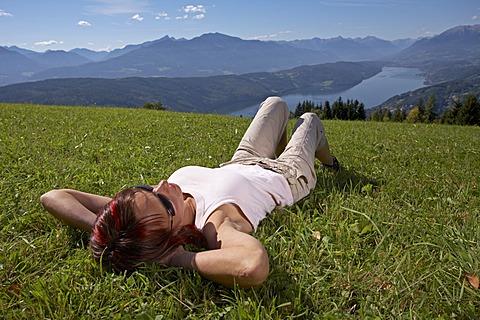 Woman on a meadow, Millstaetter See (Lake Millstatt), Carinthia