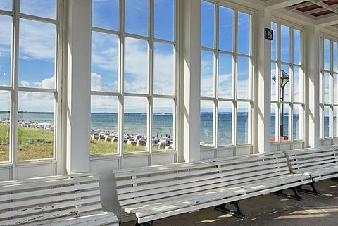 Looking through the window of the pavilion of the Kurhaus spa building towards the Baltic Sea and the beach, Baltic Sea resort town of Binz, Binz, Rügen, Mecklenburg-Western Pomerania, Germany