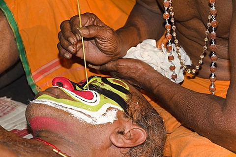 The make-up of the Kathakali character Ravana is being applied, Perattil, Kerala, India, Asia