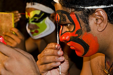 The make-up of the Kathakali character Bali is being applied, Perattil, Kerala, India, Asia