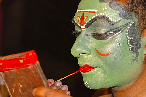 The make-up of the Kathakali character Kathalastri is being applied, Perattil, Kerala, India, Asia