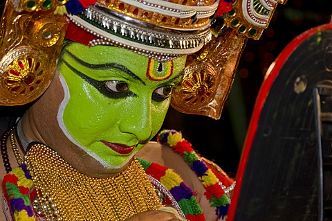 The Kathakali character Ottanthullal checking his make up, Perattil, Kerala, India, Asia