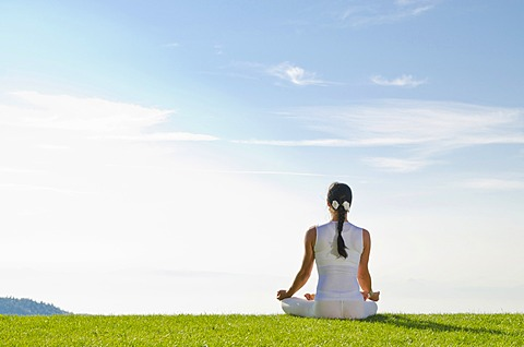Young woman practising Hatha yoga outdoors, showing the pose padmasana, lotus pose, Nove Mesto, Okres Teplice, Czech Republic, Europe