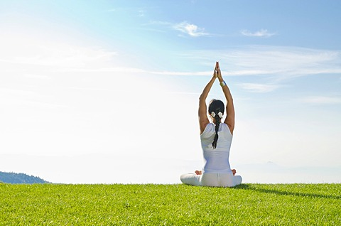 Young woman practising Hatha yoga outdoors, showing the pose merudandasana, sitting mountain pose, Nove Mesto, Okres Teplice, Czech Republic, Europe