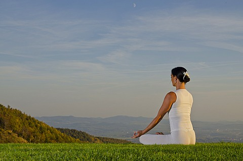 Young woman practising Hatha yoga outdoors, showing the pose padmasana, lotus pose, Nove Mesto, Okres Teplice, Czech Republik, Europe