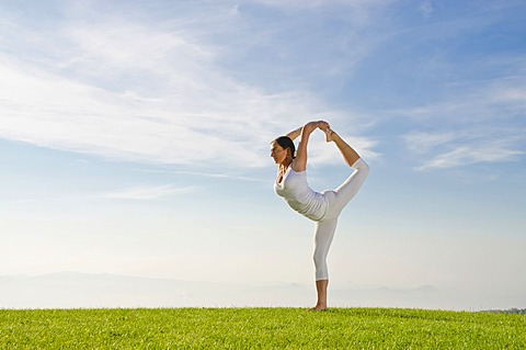 Young woman practising Hatha yoga outdoors, showing the pose natarajasana, Lord Shiva's pose, Nove Mesto, Okres Teplice, Czech Republic, Europe