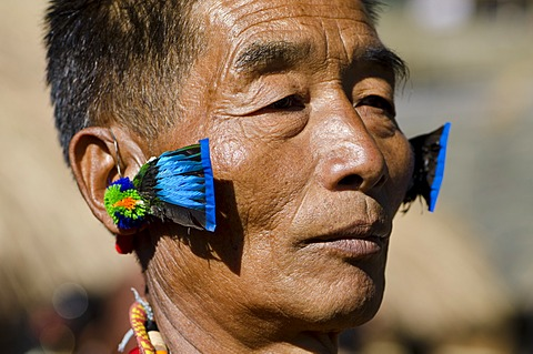 Warrior of the Kachari tribe waiting to perform ritual dances at the Hornbill Festival, Kohima, Nagaland, India, Asia