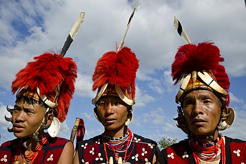 Warriors of the Yimchunger tribe waiting to perform ritual dances at the Hornbill Festival, Kohima, Nagaland, India, Asia