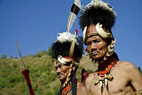 Warriors of the Konyak tribe waiting to perform ritual dances at the Hornbill Festival, Kohima, Nagaland, India, Asia