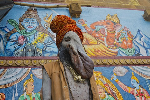 Physically disabled Sadhu, holy man, at one of the ghats of the historic city of Varanasi, India, Asia