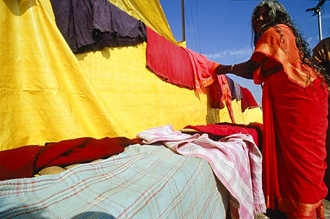 Woman drying laundry in the hot winds of Varanasi, Uttar Pradesh, India, Asia