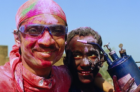 Visitors of the Holi festival, sprayed with colour powder and water, Vrindaban, Uttar Pradesh, India, Asia