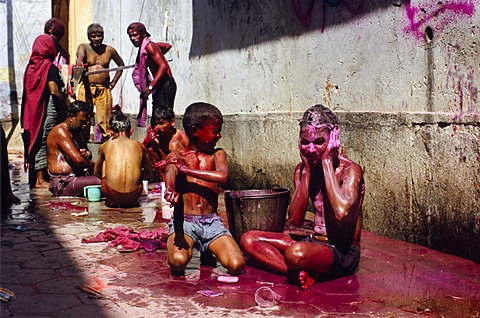 Visitors trying to clean themselves after the celebrations of Holi festival, Vrindaban, Uttar Pradesh, India, Asia