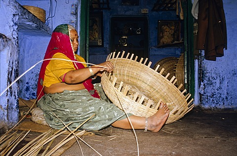 Local woman making basket from bamboo, Jodhpur, Rajasthan, India, Asia