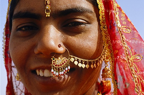 Indian woman with jewellery worn for special occasions like weddings, Jaisalmer, Rajasthan, India, Asia