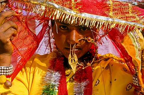 Bride with the typical wedding jewellery during the wedding ceremony, in the village of Gangi, India, Asia