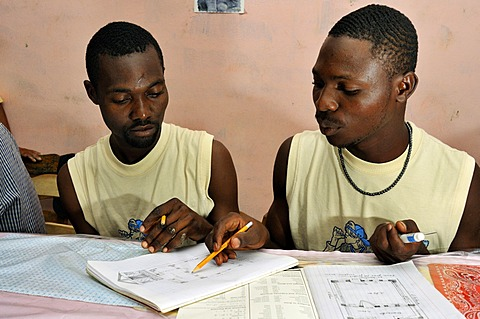 Architecture students drawing a diagram of a earthquake-proof house with truss structure. They are being trained by a German aid organization after the devastating earthquake in January 2010, Coq Chante village near Jacmel, Haiti, Caribbean, Central Ameri