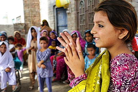 Girl participating in a hygiene campaign, instructions for handwashing, Lashari Wala village, Punjab, Pakistan, Asia