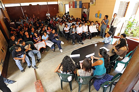 Students of the Escuela Ceiba school staging an election campaign, panel discussion, as part of their social studies class prior to the upcoming parliamentary elections, Lomas de Santa Faz slum, Guatemala City, Guatemala, Central America