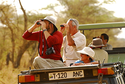 Tourists observing wildlife in Serengeti National Park, Tanzania, Africa