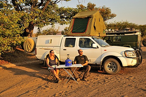Tourists in front of their camping vehicle in Twyfelfontein, Damaraland, Namibia, Africa