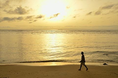 Man walking along a beach at sunset, near Kribi, Cameroon, Central Africa, Africa