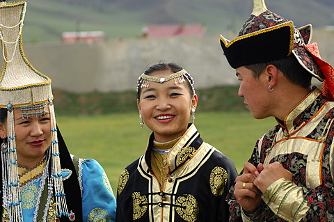 Two women and a man wearing traditional Mongolian national costumes, Ulan Bator or Ulaanbaatar, Mongolia, Asia