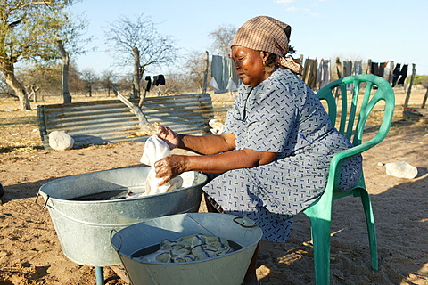 Women washing clothes in the open, Cattlepost Bothatoga, Botswana, Africa