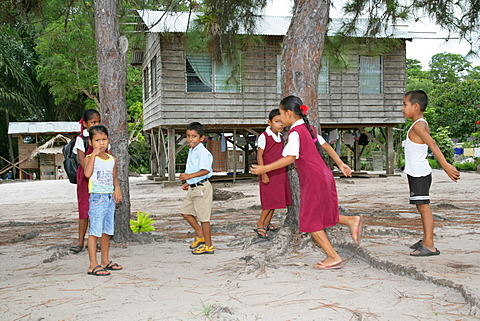 Pupils in uniform during break, Amerindians, tribe of the Arawak, Santa Mission, Guyana, South America