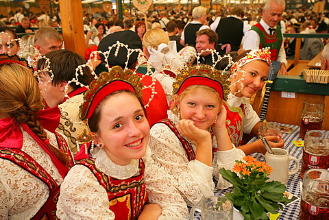 People sitting in a beer tent at an international festival for national costume, Muehldorf, Upper Bavaria, Bavaria, Germany, Europe