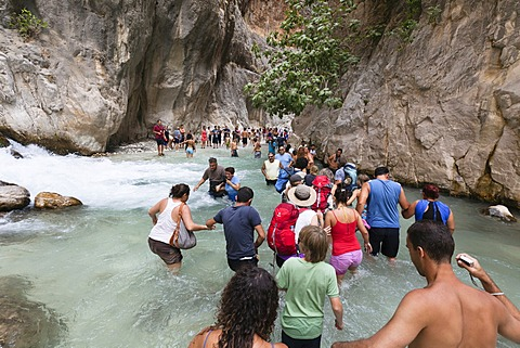 Tourists walking in the water of the gorge, Saklikent Gorge near Tlos and Fethiye, Lycian coast, Lycia, Mediterranean, Turkey, Asia Minor