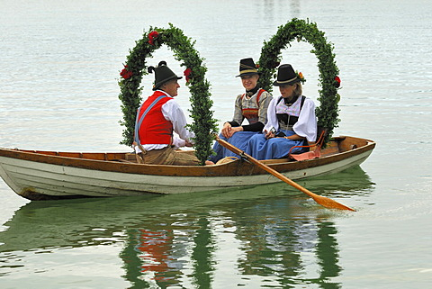 Church boat with people wearing traditional costumes at the Alt-Schliersee churchday, Lake Schliersee, Upper Bavaria, Germany, Europe