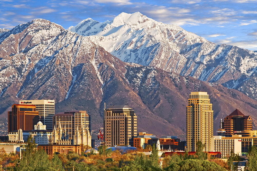 Skyline of downtown Salt Lake City with the towering Wasatch Mountain range at back, Utah, USA