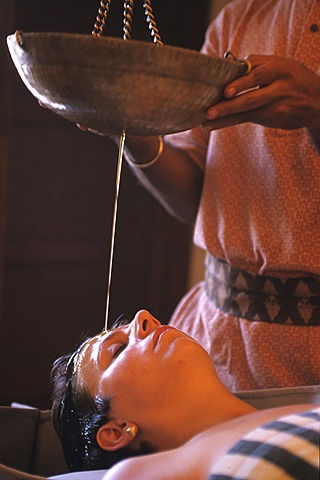 Oberoi Hotel and Resort Rajvilas. Ayurveda application with warm oil, Jaipur, Rajasthan, India