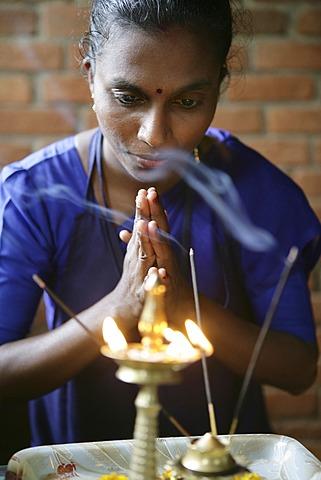 Woman praying before incense, Somatheeram Ayurveda Resort, traditional Ayurvedic medicine spa resort in Trivandrum, Kerala, India, Asia