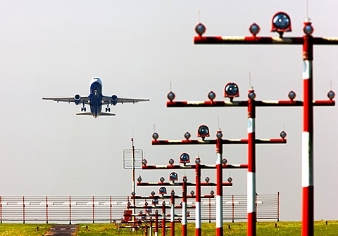 Runway landing lights in front of a British Airways Airbus A320 taking off at Duesseldorf International Airport, Duesseldorf, North Rhine-Westphalia, Germany, Europe