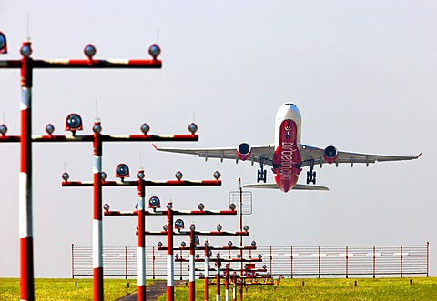 Runway landing lights in front of an Air Berlin Airbus A330 taking off at Duesseldorf International Airport, Duesseldorf, North Rhine-Westphalia, Germany, Europe
