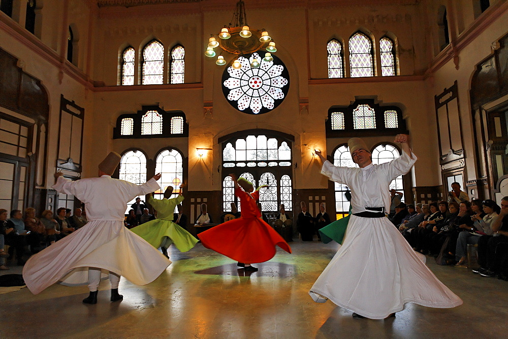 Dancing dervishes of the Sufi order Mevlevi, Sema ceremony, historic train station Sirkeci, Istanbul, Turkey