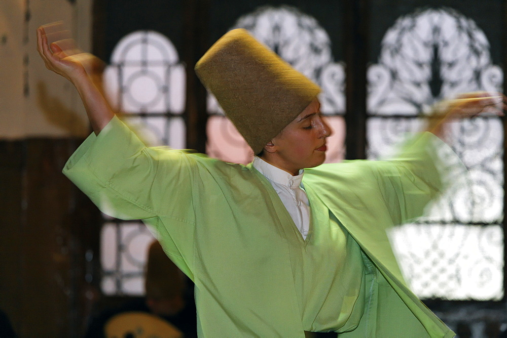 Female dancing dervish from the Sufi order Mevlevi, Sema ceremony, historic train station Sirkeci, Istanbul, Turkey