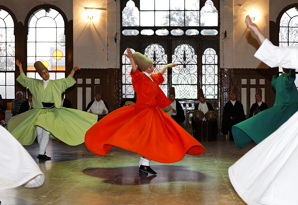 Ceremony of the dancing dervishes of the Sufi order Mevlevi, Sema ceremony, historic train station Sirkeci, Istanbul, Turkey