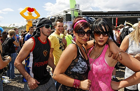 Two young female ravers posing for the camera, Loveparade 2010, Duisburg, North Rhine-Westfalia, Germany, Europe