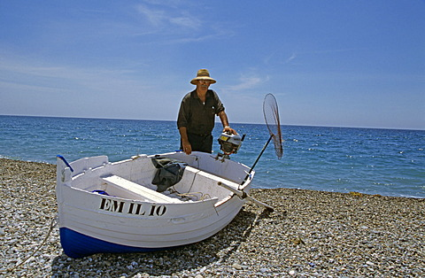 Fisherman and boat on beach, Almunecar, Andalusia, Spain, Europe