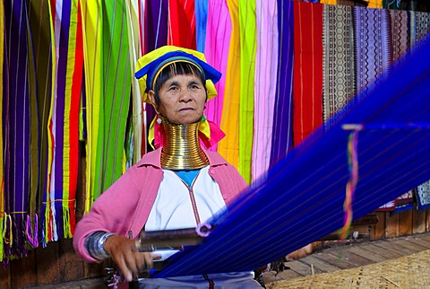 Older long-necked woman of the Karen or Padaung tribe weaving a carpet, Inle Lake, Myanmar, Burma, Southeast Asia, Asia