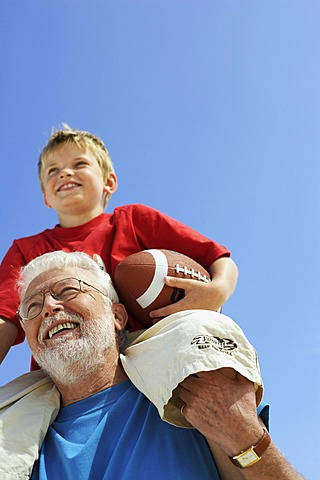 Grandfather and grandson with football