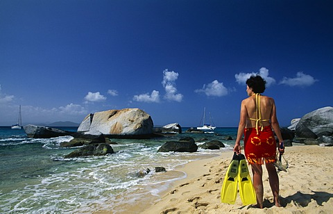 Woman with snorkelling equipment on the beach, The Baths on Virgin Gorda island, British Virgin Islands, Caribbean