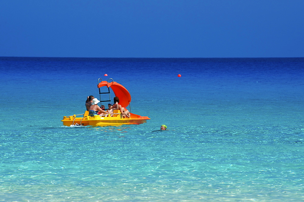 Tourists in a boat, Nissi Beach, Ayia Napa, Southern Cyprus, Cyprus